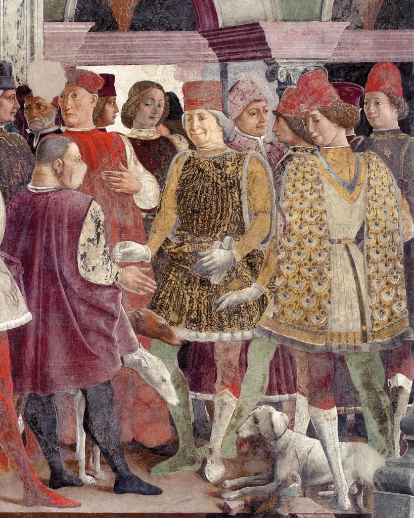 Fig. 23, Francesco del Cossa, Borso dona una moneta al buffone Scocola in presenza di Teofilo Calcagnini, 1469 circa, Ferrara, Palazzo Schifanoia, Salone dei Mesi, particolare di Aprile